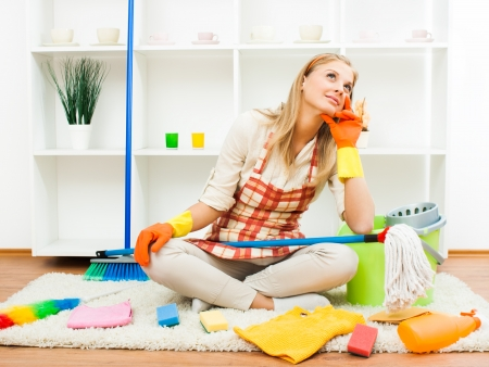 Young housewife took a break from cleaning and dreaming  Stock Photo