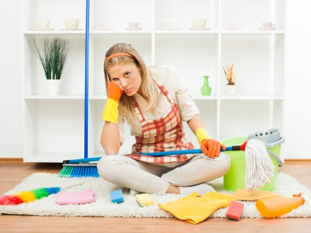 stereotypical housewife: Young housewife is tired of cleaning