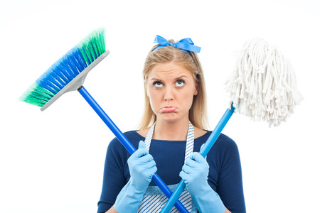 Cute housewife is sad because she has to clean  photo