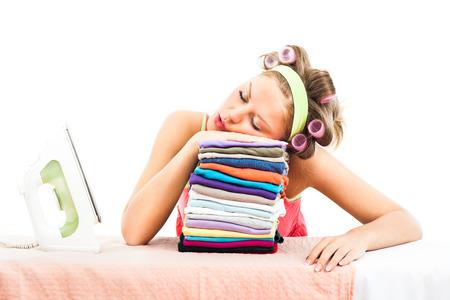 若い主婦アイロンした後眠りに落ちる 写真素材