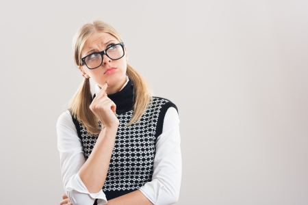 Nerdy woman is thinking about something  photo