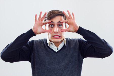 Businessman is trying to keep his eyes open in business world  photo