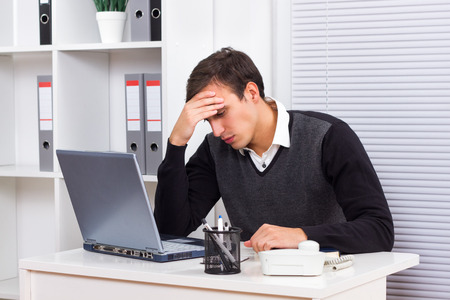tired worker: Young businessman got fed up of working