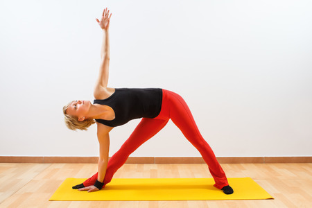 Yoga-Virabhadrasana  Rotated warrior pose photo