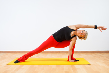 Yoga-Vasisthasana Half side plank pose photo