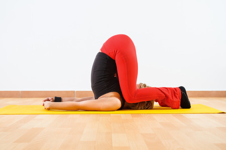 Yoga-Karnapidasana Knee To Ear Pose photo