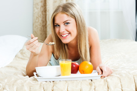 Young woman  is having healthy breakfast  photo