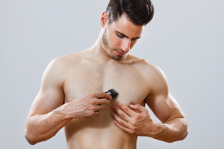 and the horizontal man: handsome man shaving chest  Stock Photo