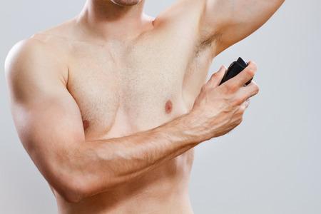handsome man using deodorant   photo