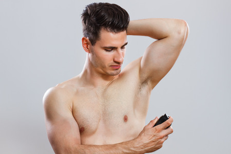 handsome man using deodorant  Stock Photo