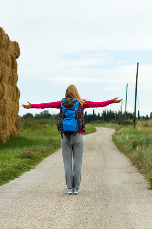 waist up: Blonde woman waist up her arms while she is standing in nature,she is feeling carefree. Stock Photo