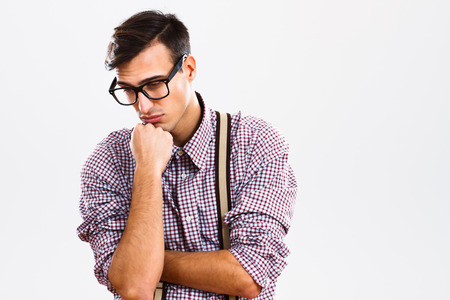 old man on a physical pressure: Nerdy man is very sad because of something.
