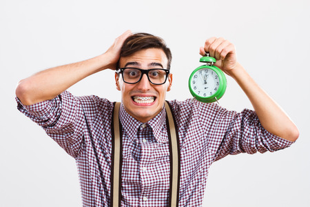 Nerdy man is in panic because he doesn't have too much time to do something. Stock Photo - 34757075