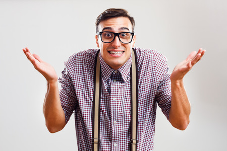 Nerdy man is confused and he doesn`t know what to do. Stock Photo