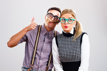 Portrait of two cute nerds having fun. photo