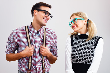 Shy nerdy woman and man are flirting.