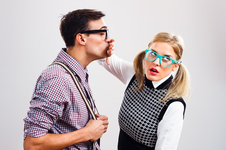 women kissing women: Nerdy man is trying to kiss his nerdy lady ,but she is pushing him away.
