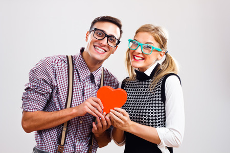 Portrait of happy nerdy couple. Stock Photo