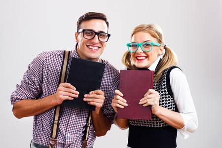 Happy nerdy man and woman  are very excited because of learning. photo