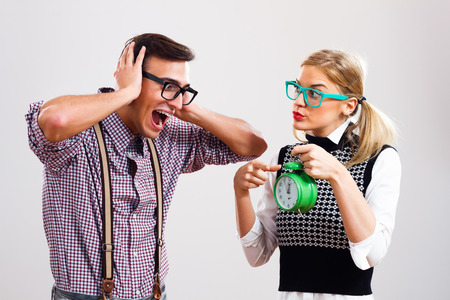 nerdy: Nerdy woman is showing to her boyfriend that time is passing by and he very frustrated.