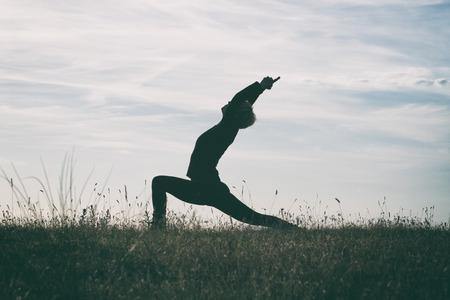 intentionally: Yoga-Virabhadrasana Warrior pose,intentionally toned image. Stock Photo