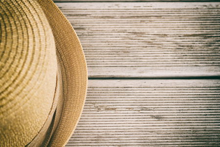 intentionally: Photo of hat on wooden table,intentionally toned image.