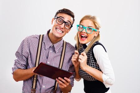 nerd: Portrait of young nerds using digital tablet.