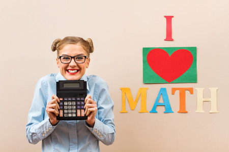 20 24 years old: Portrait of cute geek girl who loves math. Stock Photo