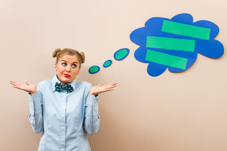 20 24 years old: Cute geek girl is having doubts about something. Stock Photo