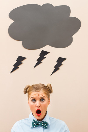 banging: Geek girl is terrified because these days luck is not on her side. Stock Photo