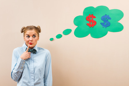 20 24 years old: Cute geek girl is thinking about money. Stock Photo