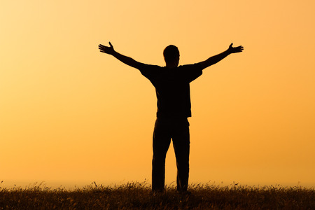 Happy man enjoys in sunset.