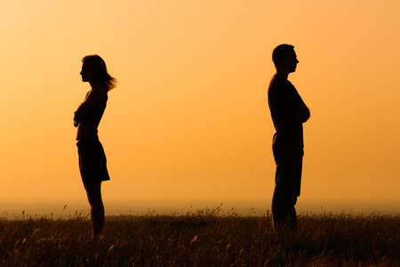 forgiveness: Silhouette of a angry woman and man on each other. Stock Photo