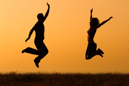 Couple in love jumping in nature.