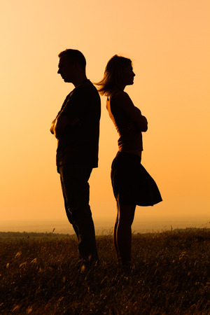 couple nature: Silhouette of a angry woman and man on each other. Stock Photo