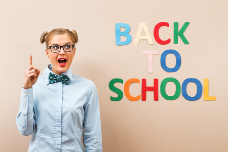 stared: Cute geek girl  has stared a new school year with new ideas.