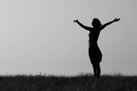 woman back of head: Happy woman enjoys outdoor.Photo is intentionally black and white. Stock Photo