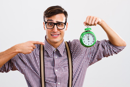 Nerdy man is in panic because he doesn't have too much time to do something. Stock Photo