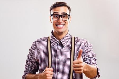 幸せなオタク男が親指が表示されます。 写真素材 - 43874510