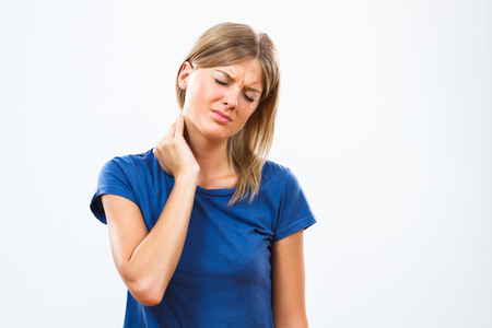 young adult women: Young woman is having neck pain. Stock Photo