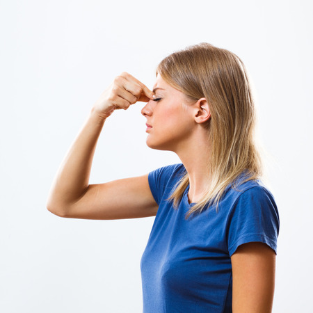Woman is having pain in sinus.