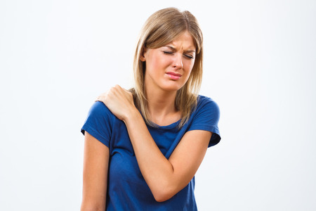 shoulder: Young woman is having  pain in her shoulder. Stock Photo