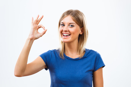 ok: Young woman showing ok sign. Stock Photo