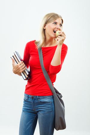 美しい女性の生食用リンゴ。 写真素材