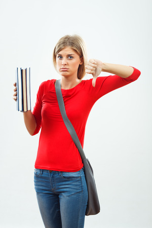 stress test: Beautiful female student doesnt want to learn. Stock Photo
