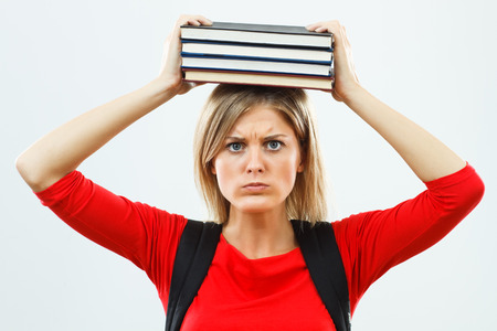 anxiety: Angry female student is fed up of learning.