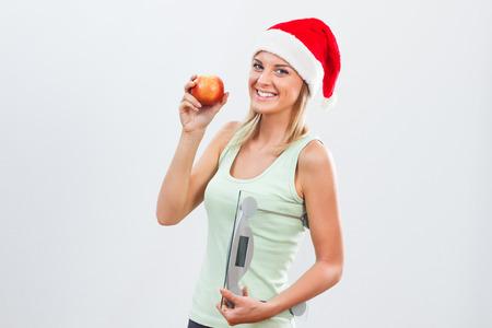 彼女は運動し、健康的な食事を続けますので、美しい女性は休日の後彼女の体重に問題をありません。