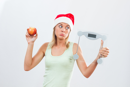 emotional stress: Young woman is sad because she has to exercise and eat healthy for holidays.