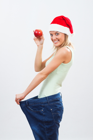 sees: Young woman is happy because sees the result of her exercise and healthy eating. Stock Photo