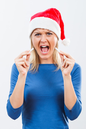 decided: Young woman is very angry because of her addiction to cigarettes and she decided to start a new life without cigarettes in the new year. Stock Photo